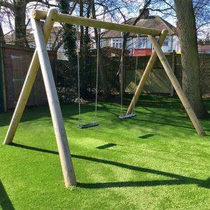 swing frame children benefits artificial grass